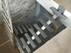 ironwood_homes_stringers_steel_modern_staircase_view_2_factor_fabrication_waukee_iowa